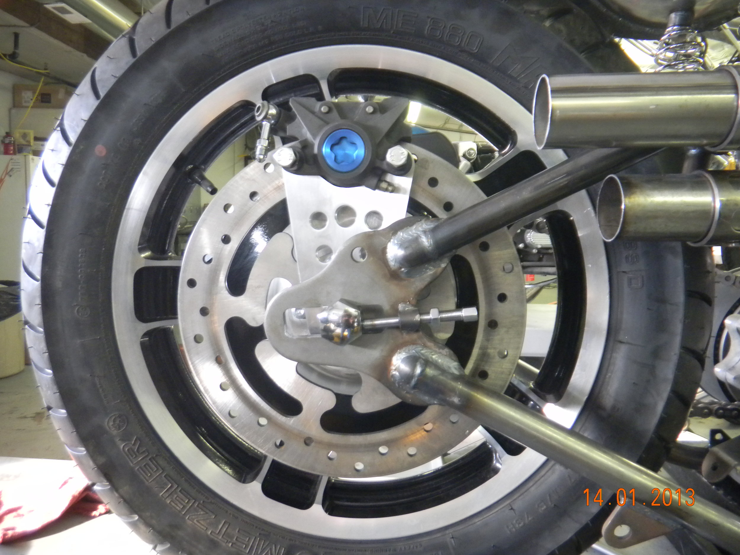REAR BRAKE MOUNT AND BRACKET
