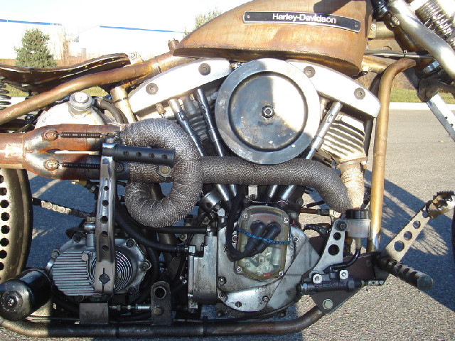 SHOVELHEAD MOTOR, DRILLED KICKER ARM, HAND MADE EXHAUST AND FORWARD CONTROLS, DRILLED REAR FENDER