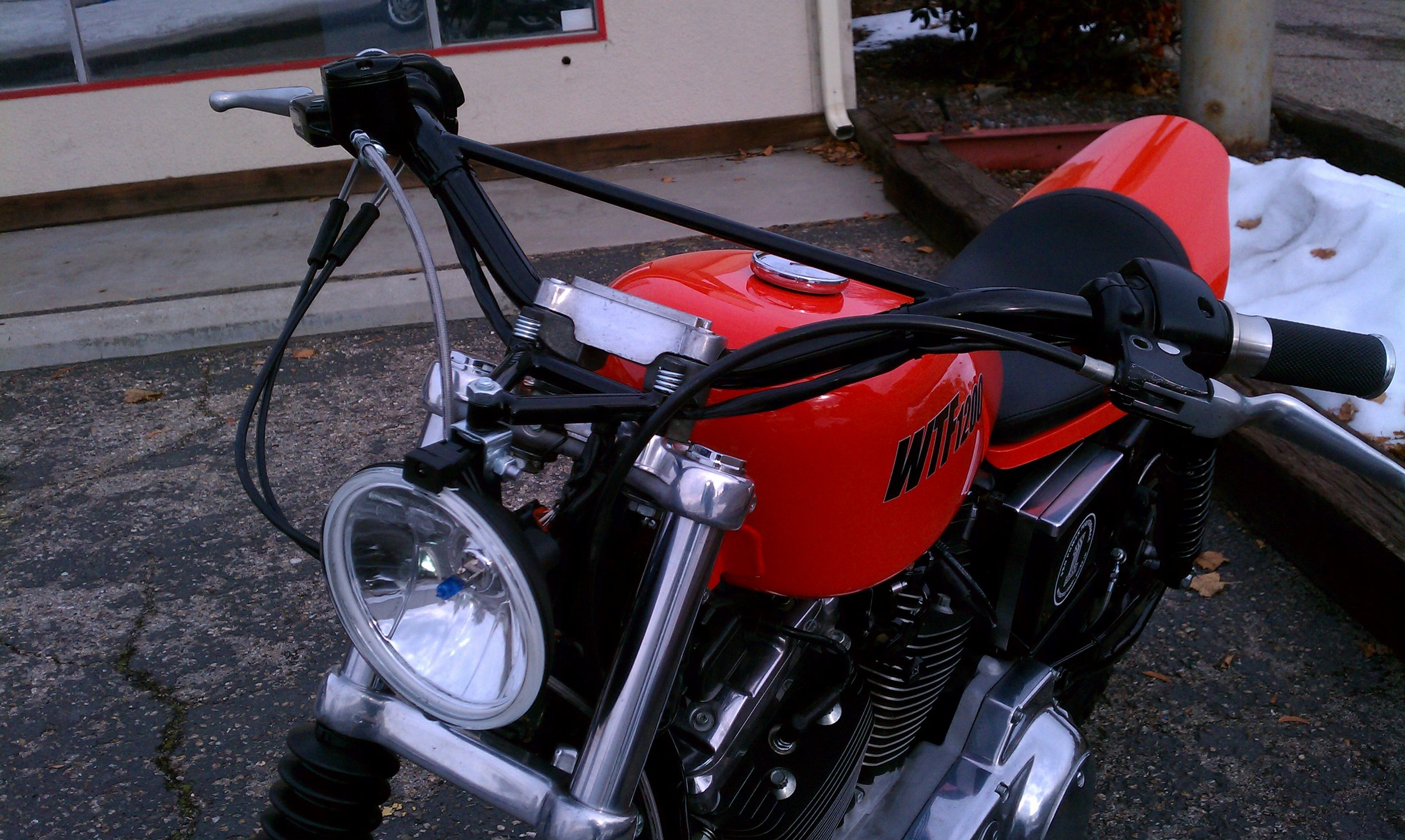 Custom handlebars and headlight mount by Todd Apple