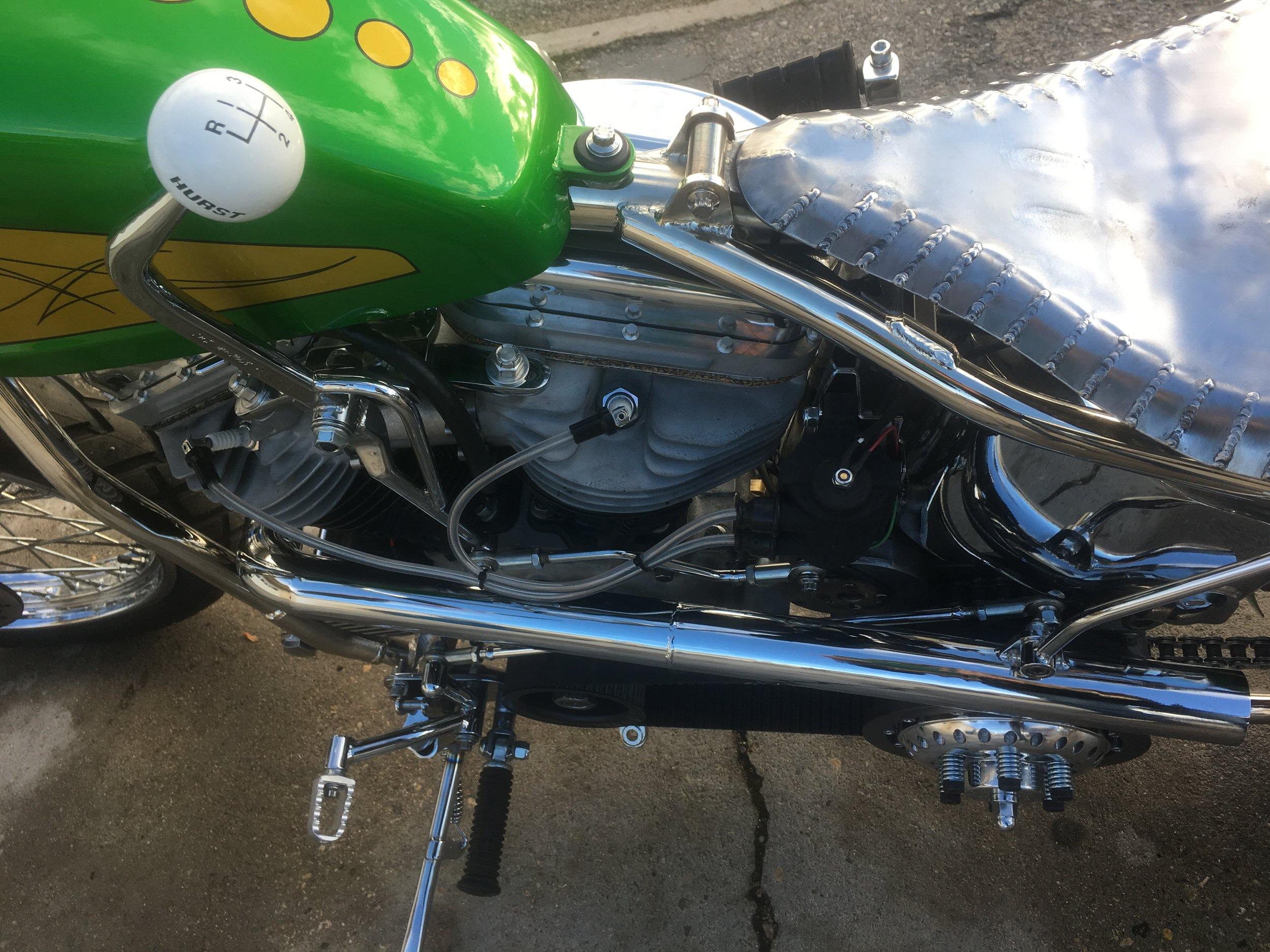 Funky shifter and linkage, sweet exhaust and exhaust bracket, forward controls and seat pan hand made by Todd Apple.