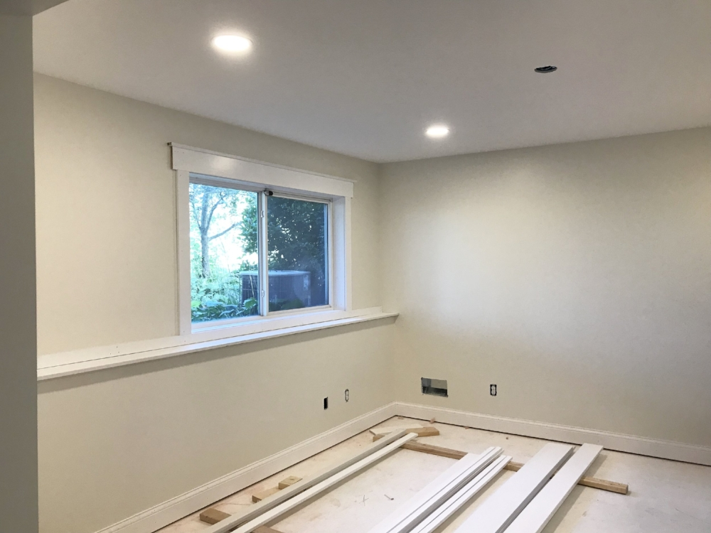 I've got walls, paint, and some trim. All that's missing is a closet door, flooring, and some barn doors. Oh, and all my STUFF.