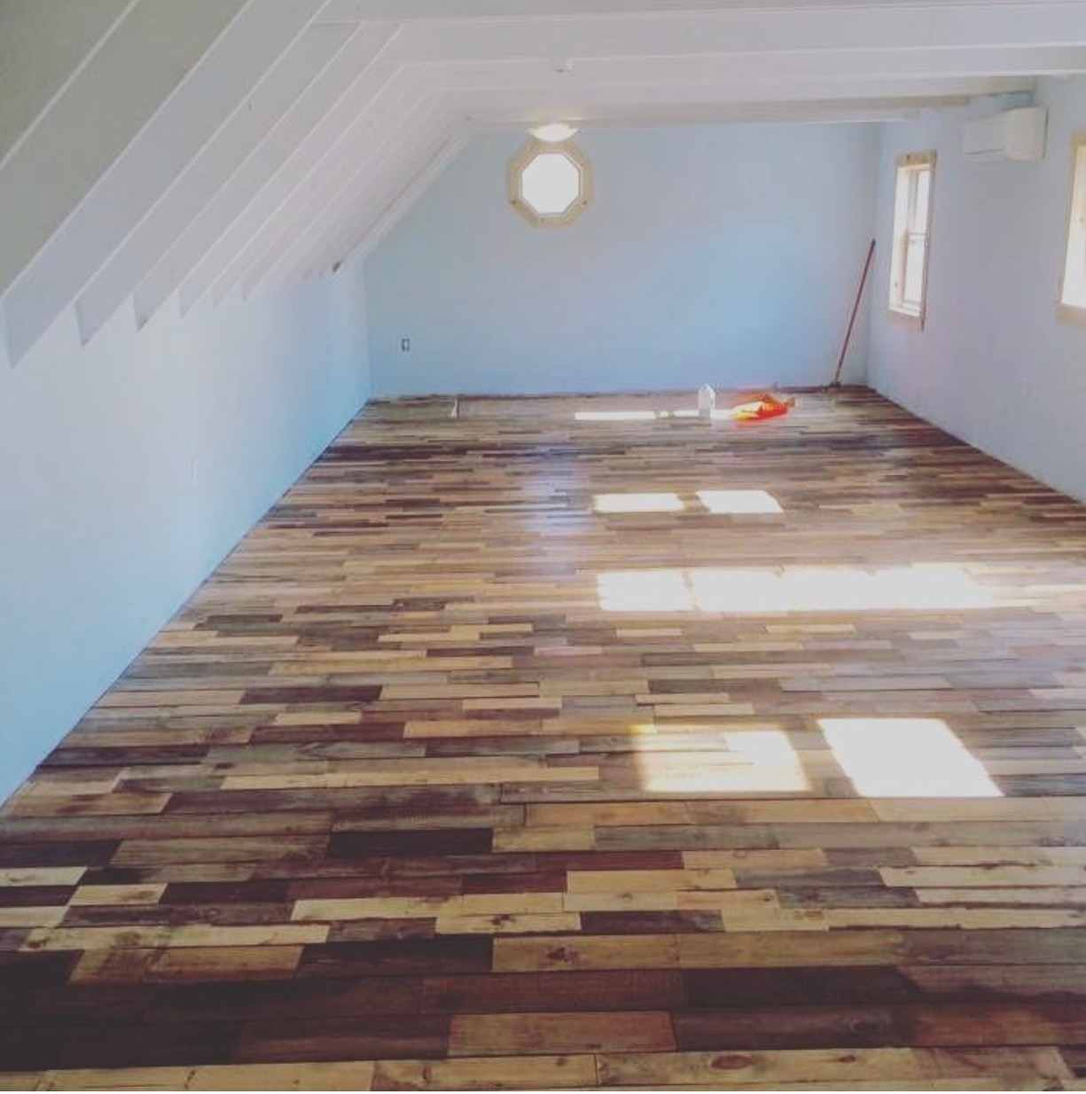 Reclaimed wood sunroom floor