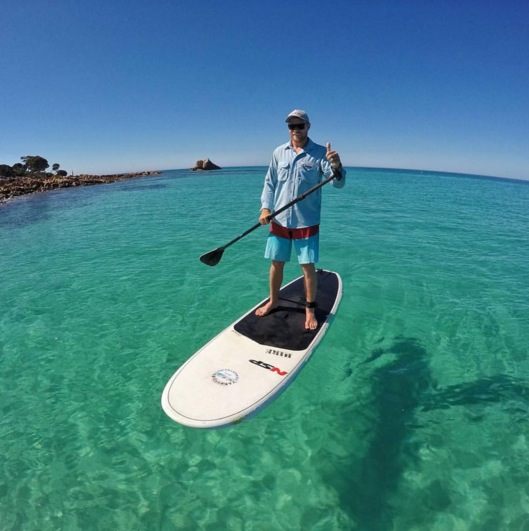 Hire a Stand Up Paddle Board (SUP) in the emerald green waters of Meelup Beach - Dunsborough. Western Australia.