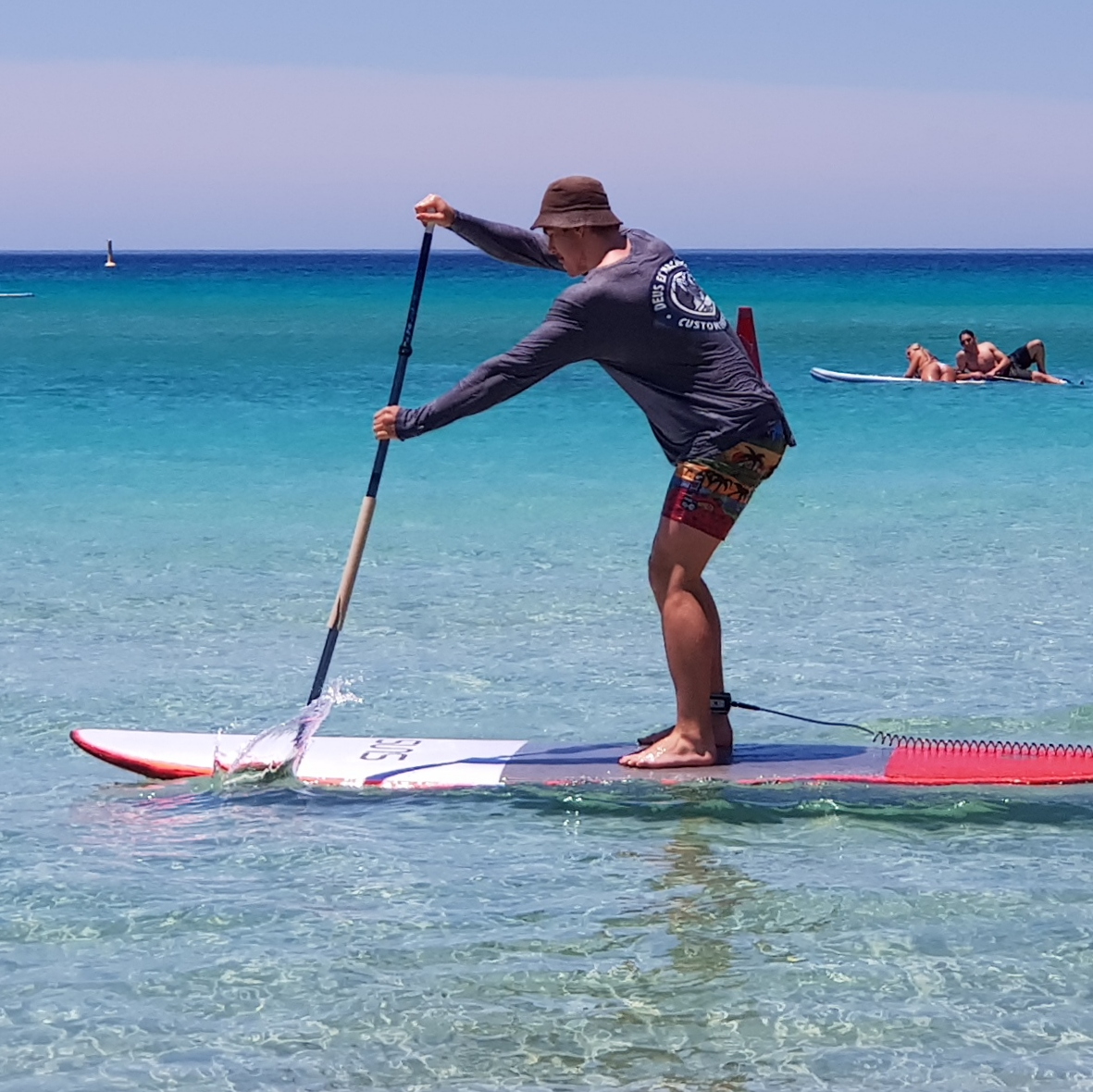 Jake Wain demonstrates good stand up paddle board technique at Meelup Beach.