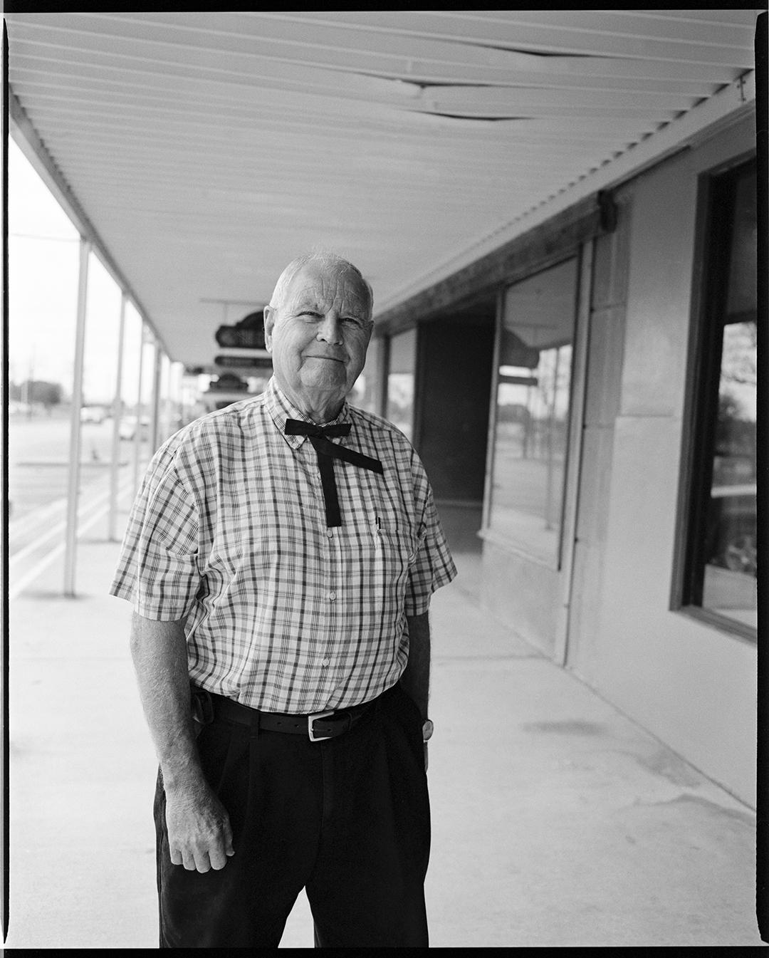 Man in western tie - Luling, TX, 2019 / Kodak TriX400 / 65mm lens at f5.6