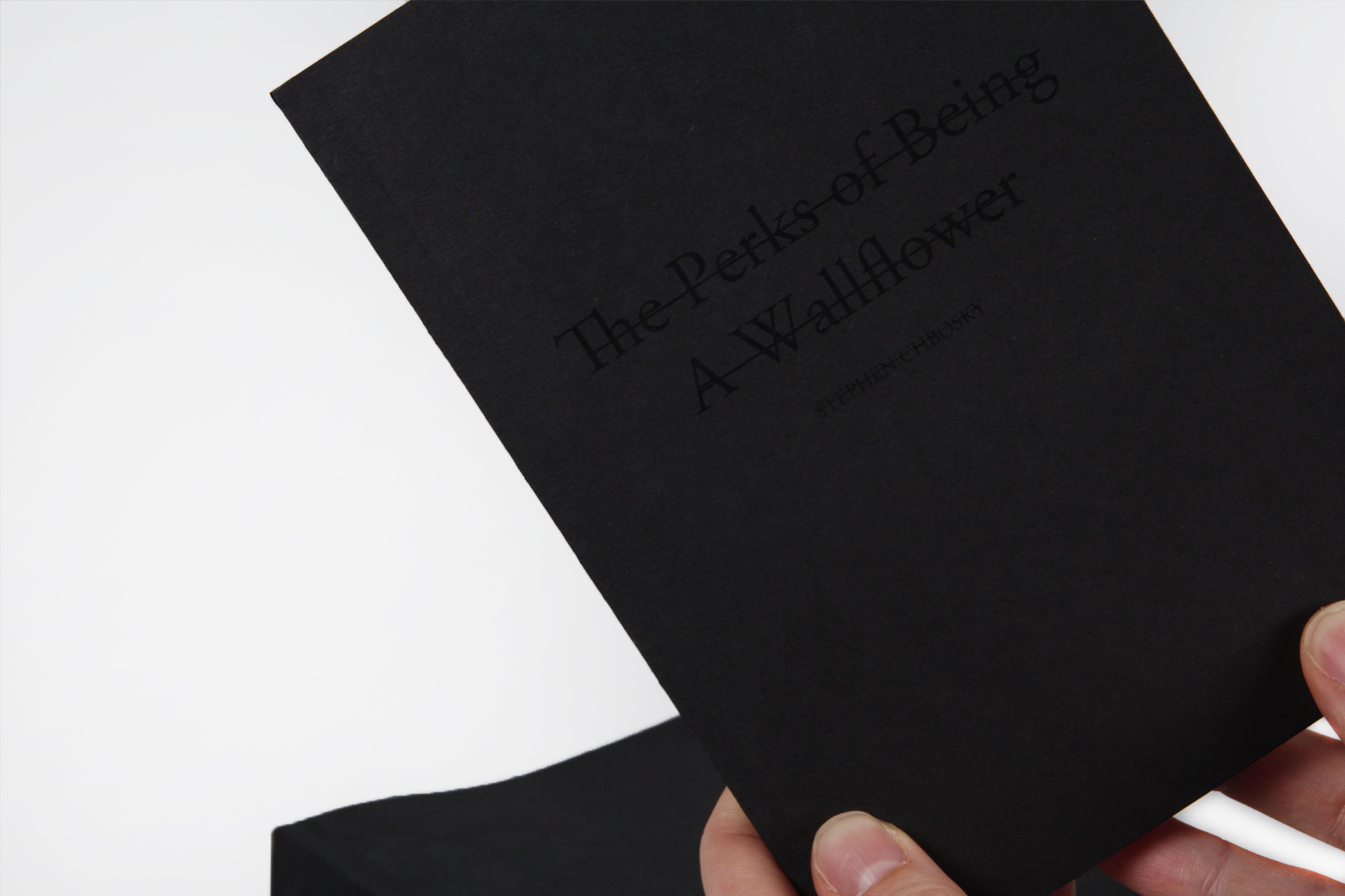 The covers all incorporate the use of black-on-black printing to obscure the text that is being presented.