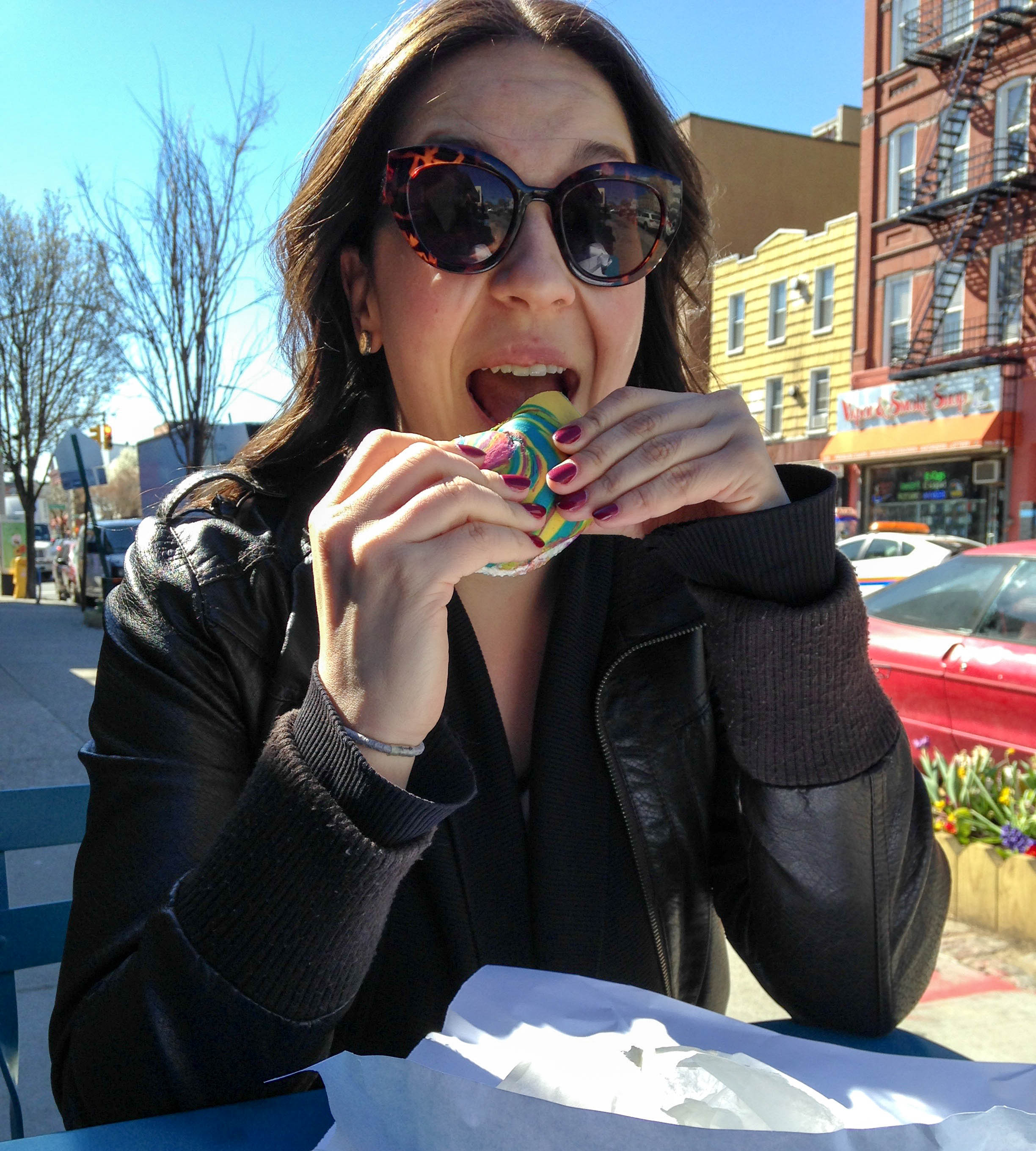 Eating a Rainbow Bagel with Cannoli Cream Cheese in Brooklyn, because why not?