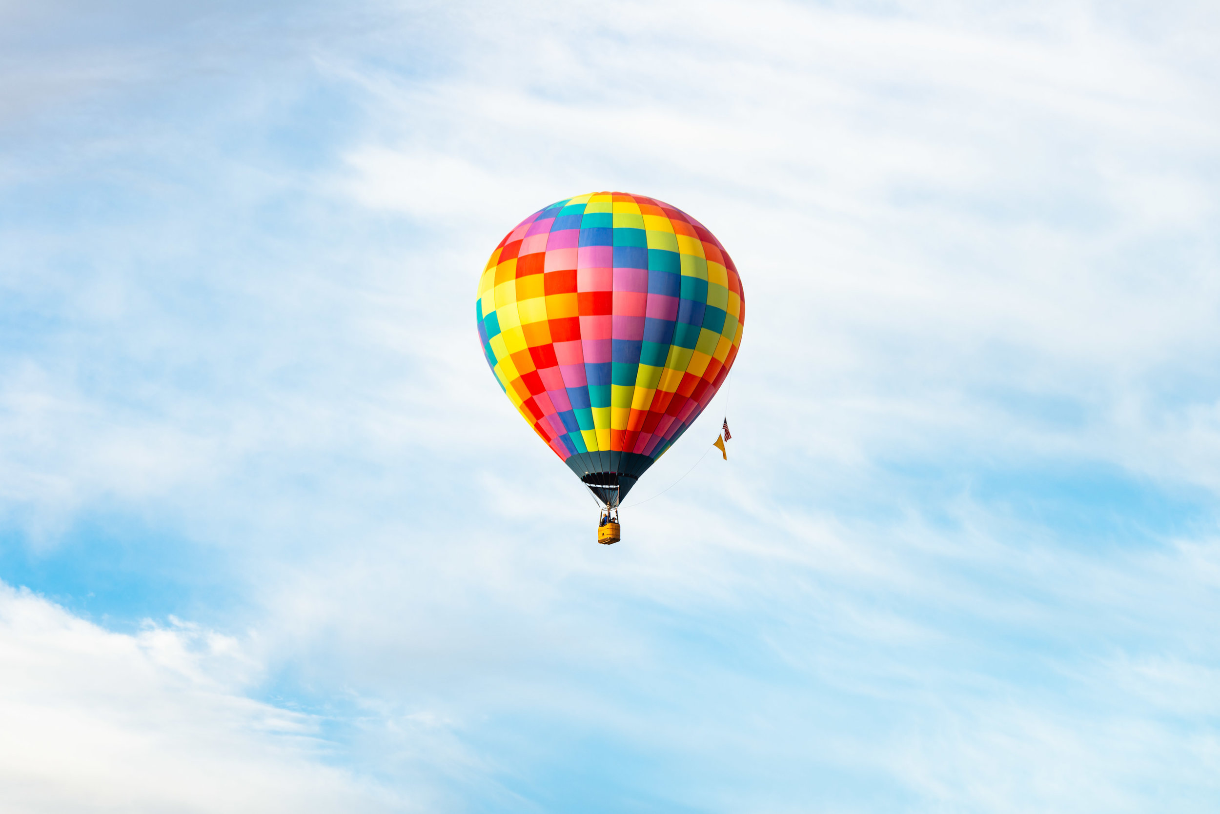 Shot at 116mm. The telephoto is great for capturing single balloons in flight.