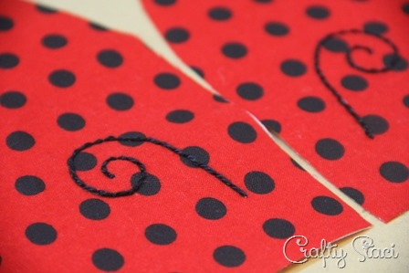Embroidered antennae on Ladybug Hot Pad