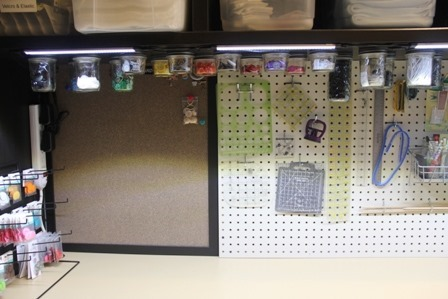 Pegboard and corkboard over craft workspace
