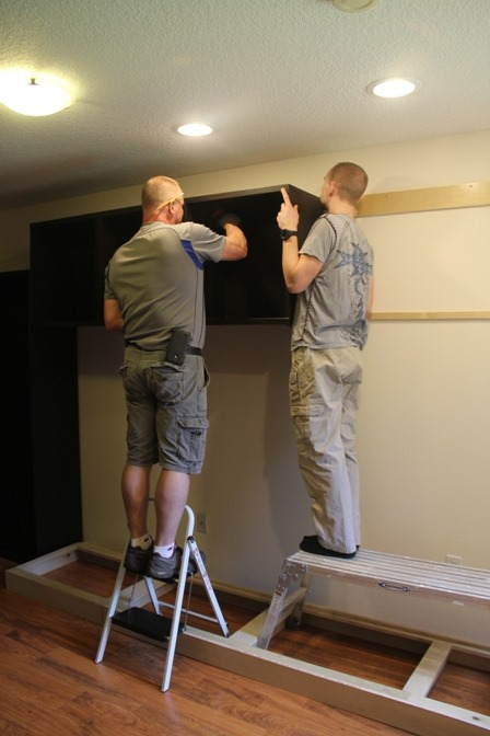 The boys installing my sewing room cabinets