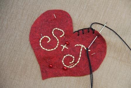 Stitching heart onto tree