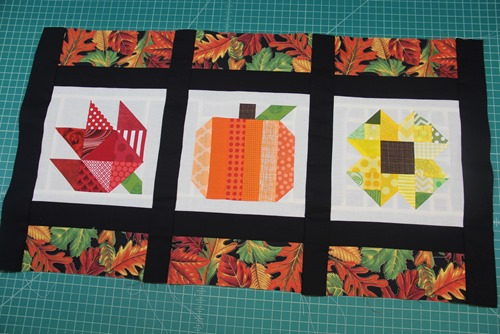 Black strips in between quilt squares