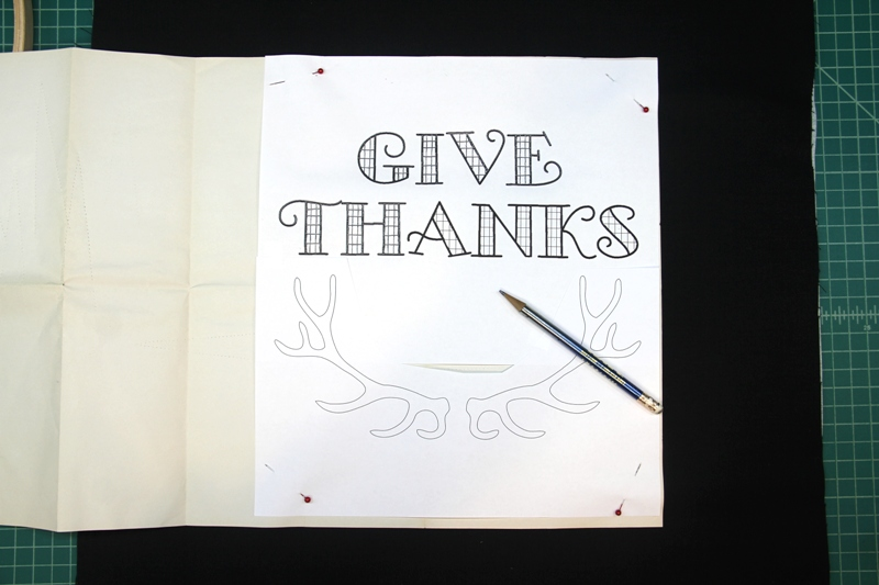 Positioning tracing paper for Give Thanks hoop art