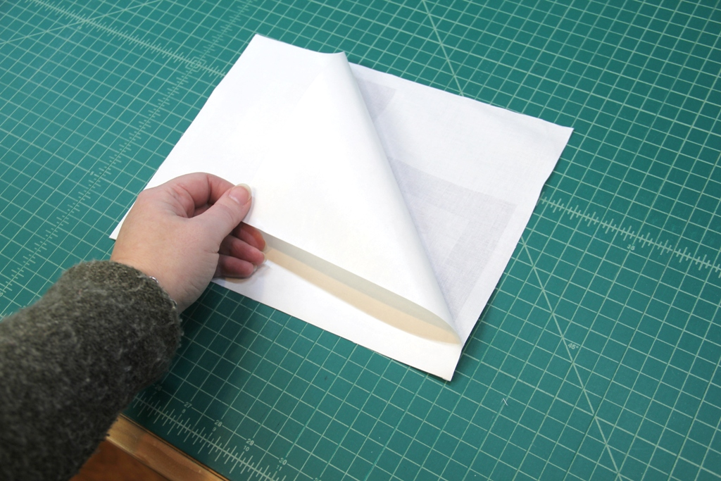 Peel paper off fabric