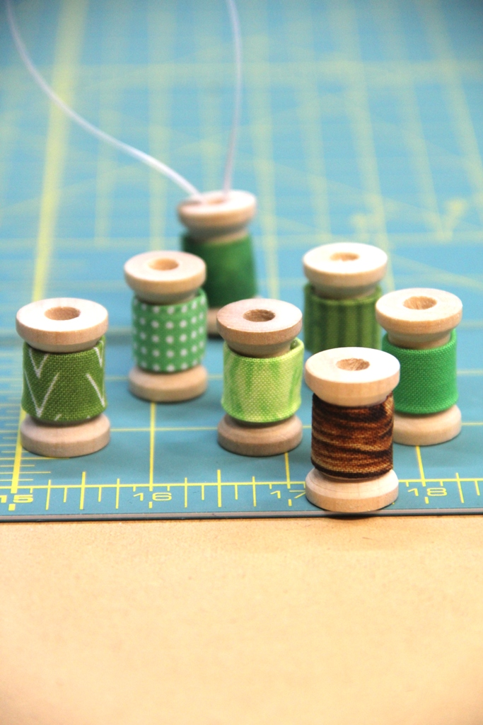 Gluing fabric to spools