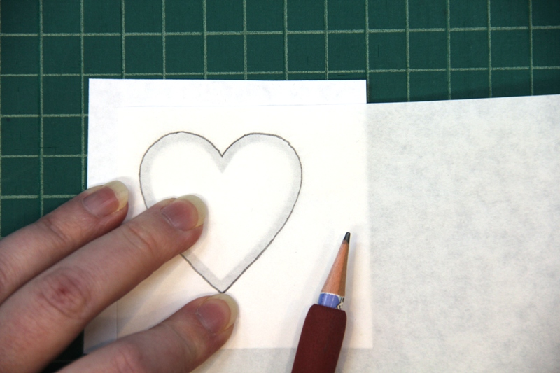 Trace heart onto freezer paper