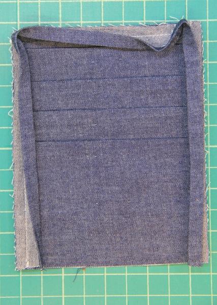 Sewing binding onto pocket
