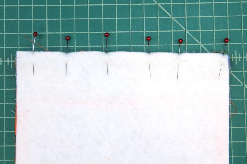 Pin front over zipper