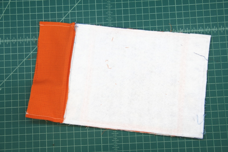 Stitch sides of mat and pocket