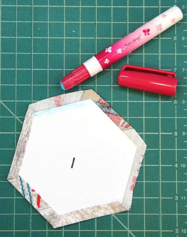 Glue edges of fabric to pattern