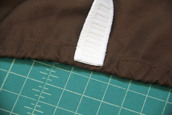 Sew elastic to edge of sheet
