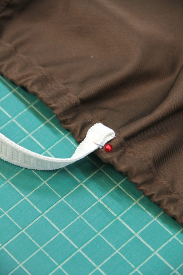 Fold elastic over and pin
