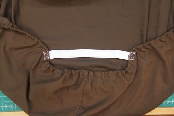 Box stitch elastic to sheet