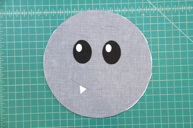 Attach tooth and eyes