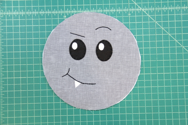 Embroider mouth and eyebrows