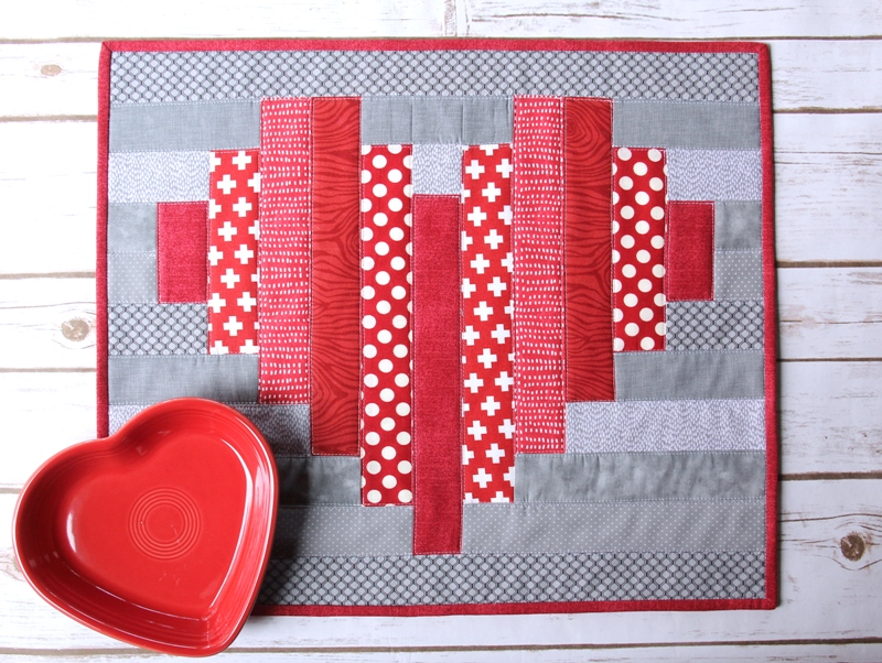 Striped Heart Mini Quilt from Crafty Staci #valentinequilt #heartquilt #heartplacemat
