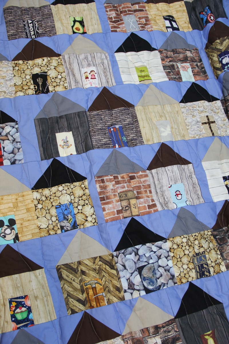 Close up of houses on village quilt