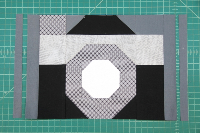 Trim sides E to width for camera quilt block