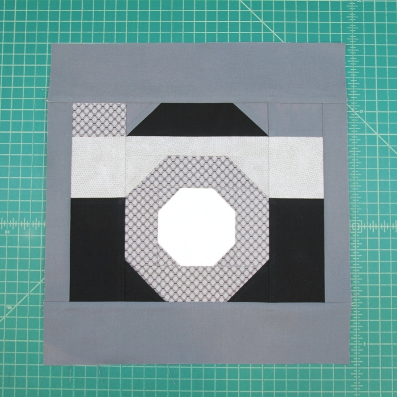 Top and bottom E pressed for camera quilt block
