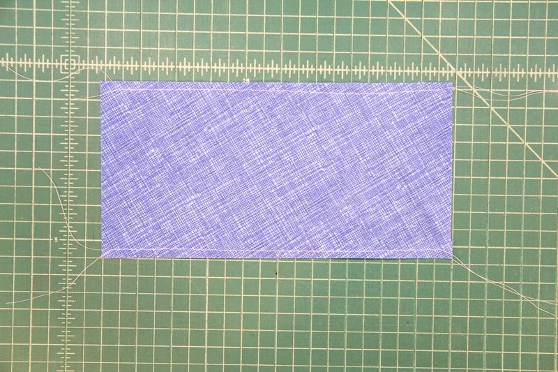 Basting stitching on blueberry pincushion