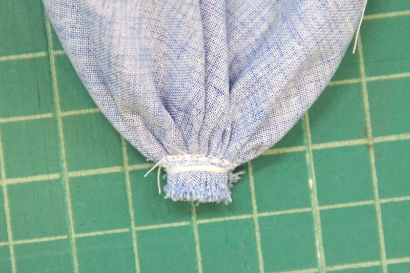 Stitching across bottom to reinforce blueberry pincushion