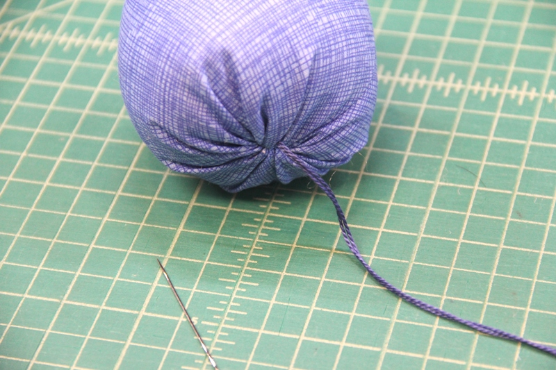 Stitch from top through bottom of blueberry pincushion