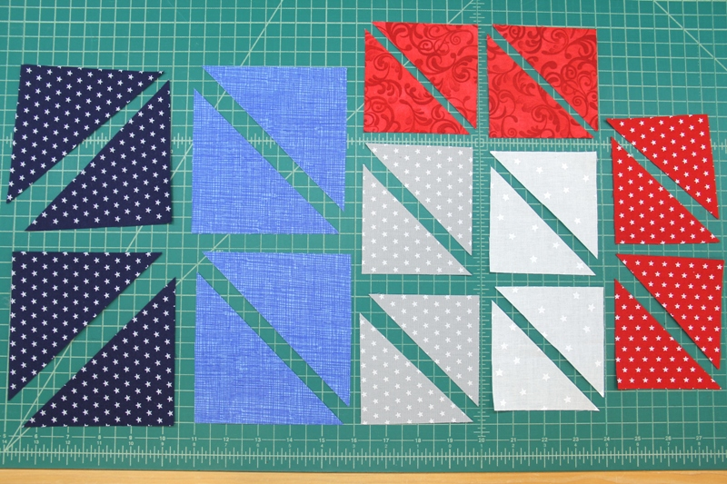 Pieces cut for pinwheel square mini quilt
