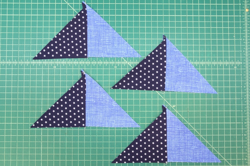 Blue pieces sewn for pinwheel square mini quilt