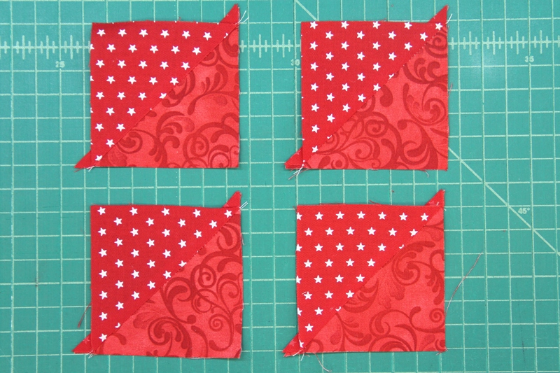 Red triangles sewn for pinwheel square mini quilt