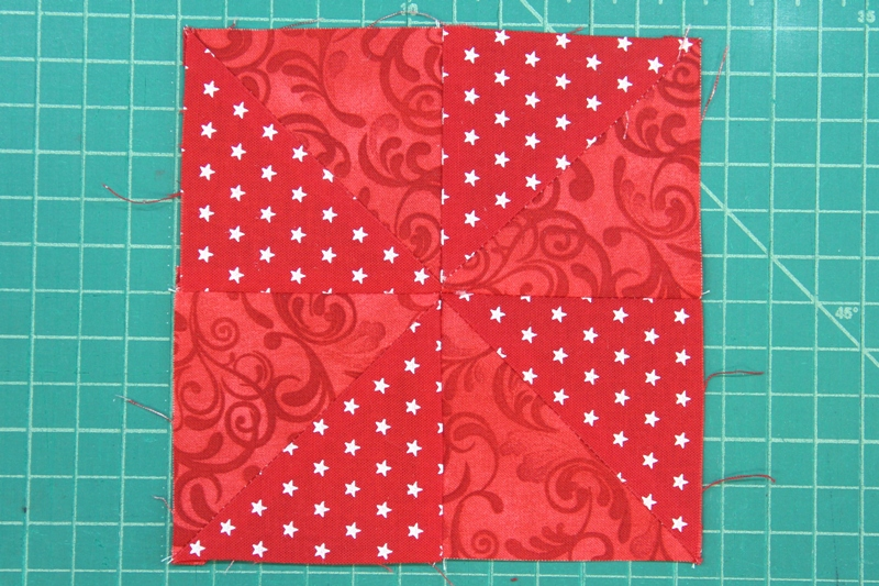 Sew two red rows together