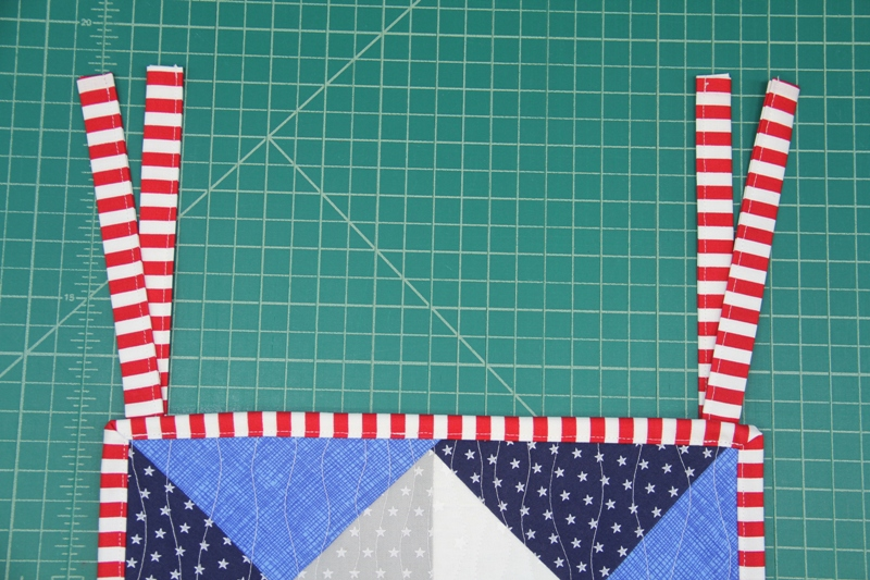 Ties sewn on to mini quilt