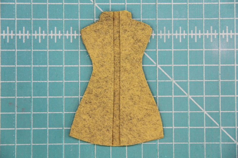 Glue center dress form to back