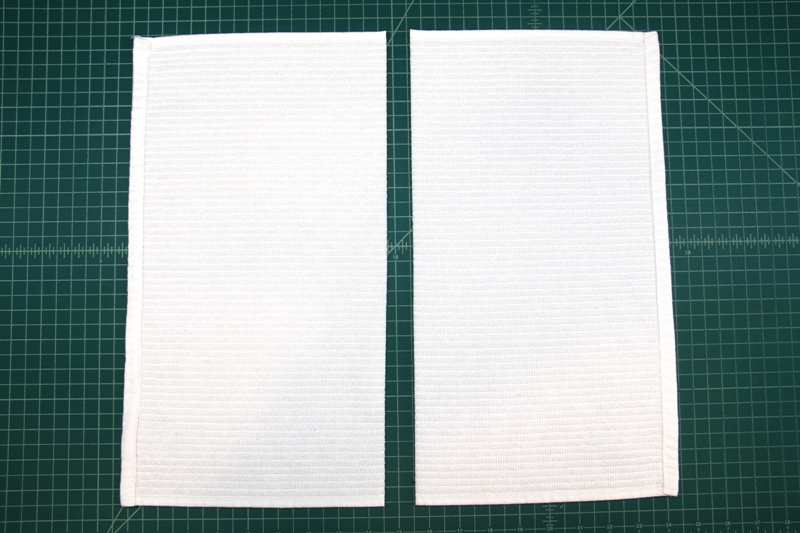 Cut dish towel in half