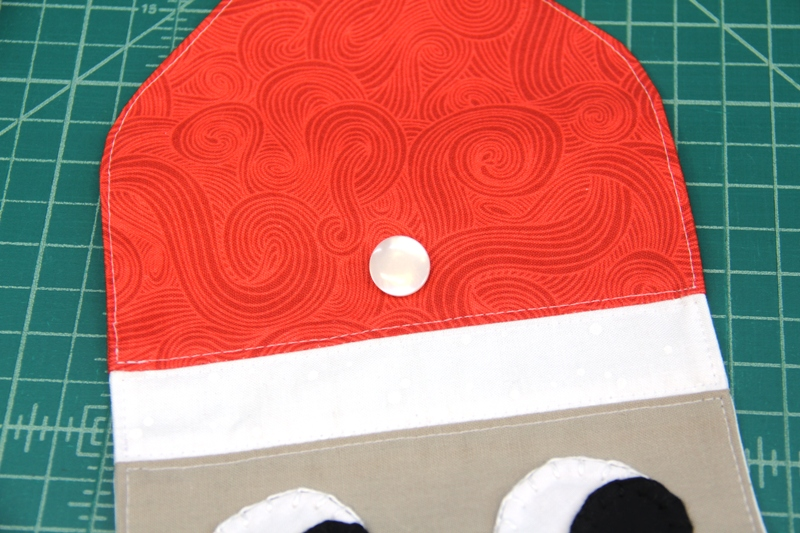 Button sewn on Santa hat