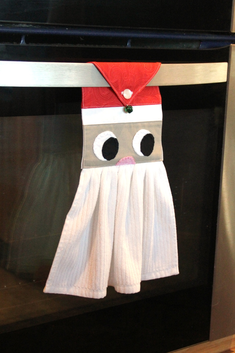 Santa towel hanging on oven door on Crafty Staci