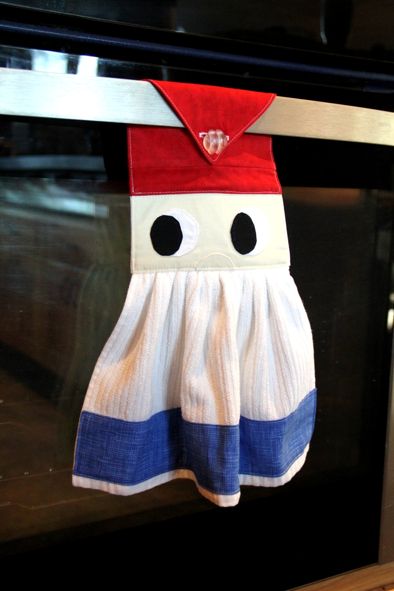 Gnome towel hanging on oven door