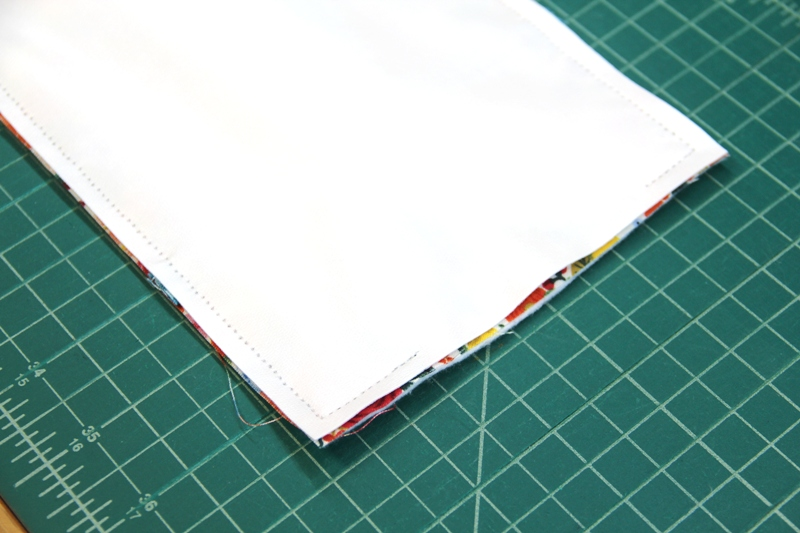 Stitching fabric to poly laminate