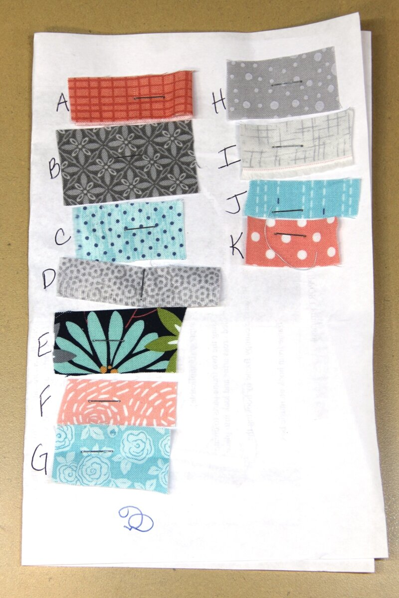 Fabric assigned to letters for quilt