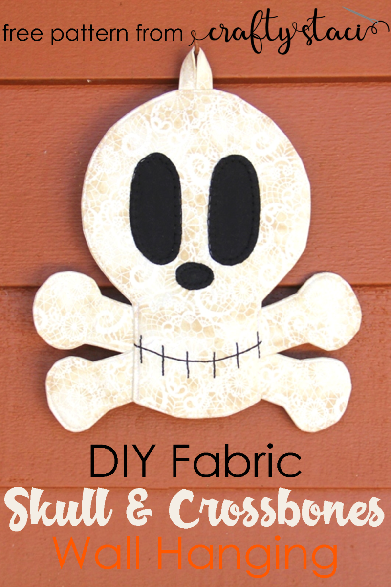 DIY Fabric Skull and Crossbones Wall Hanging from Crafty Staci #halloweendecor #skeleton #skull